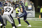 Seattle Seahawks quarterback Paxton Lynch (2) looks to pass against the Oakland Raiders during the second half of an NFL football preseason game Thursday, Aug. 29, 2019, in Seattle. (AP Photo/Elaine Thompson)