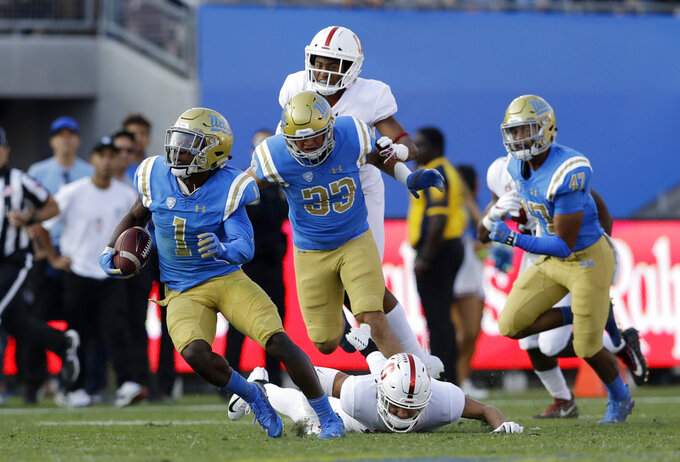 UCLA's Darnay Holmes (1) returns a kick for a touchdown during the second half of an NCAA college football game against Stanford Saturday, Nov. 24, 2018, in Pasadena, Calif. (AP Photo/Marcio Jose Sanchez)