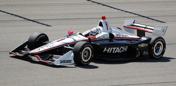 FILE - In this July 8, 2018, file photo, Josef Newgarden competes during an IndyCar Series auto race at Iowa Speedway in Newton, Iowa. Newgarden already has his first IndyCar season championship. He goes into the back half of this year's 17-race schedule already with three wins, and is out front again in the title chase. (AP Photo/Charlie Neibergall, File)