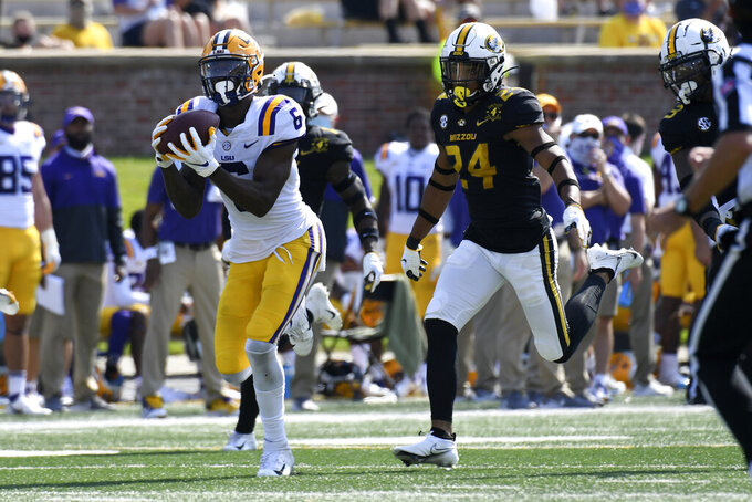 LSU wide receiver Terrace Marshall Jr. (6) catches a touchdown pass during the second half of an NCAA college football game as Missouri defensive back Ishmael Burdine (24) defends Saturday, Oct. 10, 2020, in Columbia, Mo. (AP Photo/L.G. Patterson)