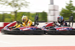 NASCAR Cup Series driver Kyle Busch, left, and Camping World Truck Series driver John Hunter Nemechek race on the Circuit of the Americas karting course, Monday, April 19, 2021, in Austin, Texas. NASCAR's inaugural race at Circuit of The Americas will be held the weekend of May 21-23. (AP Photo/Eric Gay)