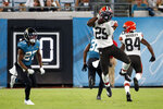 Cleveland Browns running back Demetric Felton (25) makes a reception in front of Jacksonville Jaguars cornerback Chris Claybrooks, left, during the first half of an NFL preseason football game, Saturday, Aug. 14, 2021, in Jacksonville, Fla. (AP Photo/Stephen B. Morton)