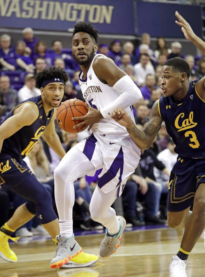 Washington's Jaylen Nowell, center, drives between California's Justice Sueing, left, and Paris Austin during the first half of an NCAA college basketball game Saturday, Jan. 19, 2019, in Seattle. (AP Photo/Elaine Thompson)
