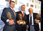 FILE - In this Oct. 31, 2014, file photo, from left, James Bates, Ben Zambiasi and Pat Dye pose with their busts after induction into the Georgia-Florida Hall of Fame in Jacksonville, Fla. Former Auburn coach Pat Dye, who took over a downtrodden football program in 1981 and turned it into a Southeastern Conference power, has died. He was 80. Lee County Coroner Bill Harris said Dye passed away Monday, June 1, 2020, at the Compassus Bethany House in Auburn, Ala. A native of Augusta, Ga., Dye played football for Wally Butts at the University of Georgia from 1958-60 before coaching at Auburn, Wyoming and East Carolina. (Bruce Lipsky/The Florida Times-Union via AP, File)
