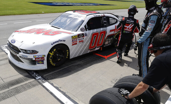 Cole Custer drives to the track after making a pit stop during a NASCAR Xfinity Series auto race at Chicagoland Speedway in Joliet, Ill., Saturday, June 29, 2018. (AP Photo/Nam Y. Huh)
