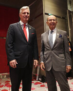U.S. National Security Adviser Robert O'Brien, left, and Commerce Secretary Wilbur Ross arrive for the bilateral meeting with Japanese Prime Minister Shinzo Abe at the Association of Southeast Asian Nations (ASEAN) summit in Nonthaburi, Thailand, Monday, Nov. 4, 2019. (AP Photo/Aijaz Rahi)