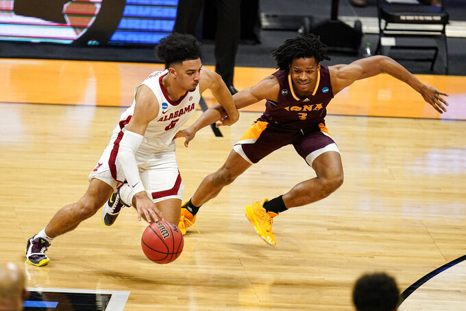 FILE - In this March 20, 2021, file photo, Alabama guard Jaden Shackelford (5) drives on Iona guard Ryan Myers (3) during the first half of a first-round game in the NCAA men's college basketball tournament at Hinkle Fieldhouse in Indianapolis. (AP Photo/Michael Conroy, File)
