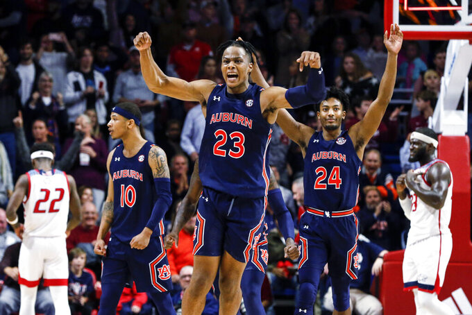 Auburn forward Isaac Okoro (23) and Auburn forward Anfernee McLemore (24) celebrate after defeating South Alabama during the second half of an NCAA college basketball game, Tuesday, Nov. 12, 2019, in Mobile, Ala. Auburn won 70-69. (AP Photo/Butch Dill)