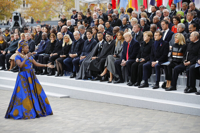 FILE - In this Sunday, Nov. 11, 2018 file photo Benin's Angelique Kidjo performs in front of heads of states and world leaders during ceremonies at the Arc de Triomphe in Paris. One of Africa's iconic artists, Kiddo, is the voice of a new project aimed at rewriting laws across the African continent that keep millions of women from becoming a more powerful economic force. (AP Photo/Francois Mori, Pool, File)