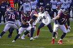 Houston Texans quarterback Deshaun Watson (4) is pressured by Chicago Bears' Robert Quinn (94) during the first half of an NFL football game, Sunday, Dec. 13, 2020, in Chicago. (AP Photo/Charles Rex Arbogast)