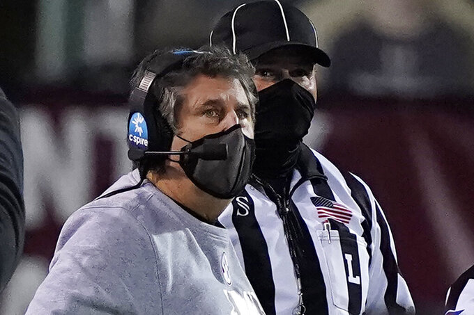 Mississippi State head coach Mike Leach looks at the scoreboard in the second half of an NCAA college football game against Missouri, Saturday, Dec. 19, 2019, in Starkville, Miss. (AP Photo/Rogelio V. Solis)