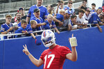 Buffalo Bills quarterback Josh Allen (17) takes the field before practice at NFL football training camp in Orchard Park, N.Y., on Saturday, July 31, 2021. (AP Photo/Joshua Bessex)