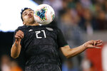 Mexico defender Jorge Sanchez (21) gets the ball on his chin after attempting a header during the second half of the team's international friendly soccer match against the the United States, Friday, Sept. 6, 2019, in East Rutherford, N.J. Mexico won 3-0. (AP Photo/Kathy Willens)