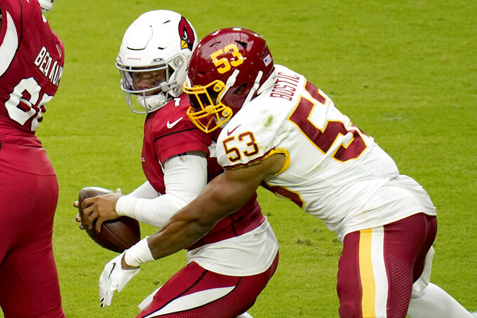 Arizona Cardinals quarterback Kyler Murray (1) is sacked by Washington Football Team inside linebacker Jon Bostic (53) during the first half of an NFL football game, Sunday, Sept. 20, 2020, in Glendale, Ariz. (AP Photo/Ross D. Franklin)