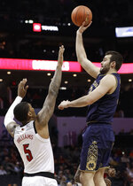 Notre Dame's John Mooney, right, shoots against Louisville's Malik Williams (5) during the first half of an NCAA college basketball game in the Atlantic Coast Conference tournament in Charlotte, N.C., Wednesday, March 13, 2019. (AP Photo/Chuck Burton)
