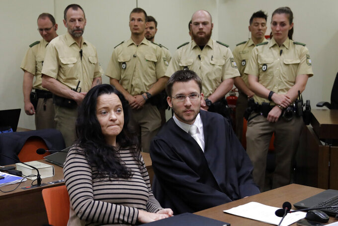 FILE-In this June 20, 2017 taken photo terror suspect Beate Zschaepe sits in the court room besides her lawyer Mathias Grasel in Munich, Germany. Germany's top court has rejected appeals by three defendants over their convictions in one of the country's most high-profile far-right murder trials. The decision announced Thursday by the Federal Court of Justice confirms the life sentence given three years ago to Beate Zschaepe, the only known survivor of the National Socialist Underground group. (AP Photo/Matthias Schrader)
