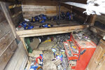 This Wednesday, Nov. 20, 2019 photo provided by the Milwaukee County Sheriff's Office shows the interior of underground bunker where Geoffrey Graff was arrested after sheriff's deputies found a stash of weapons in the bunker in a secluded, wooded area along the Milwaukee River on Milwaukee, Wis. Milwaukee County Sheriff Earnell Lucas said it's possible that Graff, 41, had been living in the bunker for