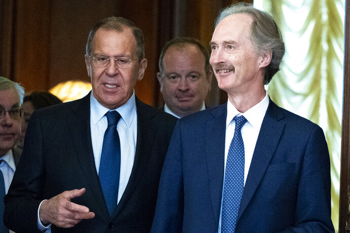 United Nations Special Envoy for Syria Geir Pedersen, center, and Russian Foreign Minister Sergey Lavrov, second from right, enter a hall during their meeting in Moscow, Russia, Friday, July 5, 2019. Pedersen voiced hope that cooperation between Russia and Turkey will help stabilize the situation in Syria's northwestern provice of Idlib. (AP Photo/Pavel Golovkin)