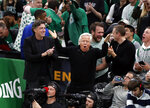 New England Patriots owner Robert Kraft, center, cheers on the Boston Celtics with Celtics owner Wyc Grousbeck, left, during the third quarter in Game 1 of a first-round NBA basketball playoff series between the Celtics and the Indiana Pacers, Sunday, April 14, 2019, in Boston. (AP Photo/Winslow Townson)