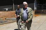 United States District Judge William Alsup, right, leaves the Paradise Performing Arts Center during a tour of fire ravaged Paradise, Calif., Friday June 7, 2019. Alsup ordered the top officials of Pacific Gas & Electric Co. to tour the destruction caused last November's Camp Fire. Alsup joined them on tour. (AP Photo/Rich Pedroncelli)