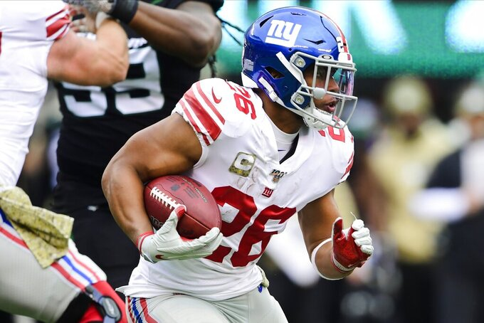 New York Giants running back Saquon Barkley (26) rushes during the first half of an NFL football game against the New York Jets, Sunday, Nov. 10, 2019, in East Rutherford, N.J. (AP Photo/Steven Ryan)
