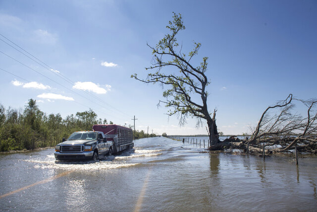 Floodwater covers a road just southeast of Lake Charles, La., following Hurricane Delta on Saturday, Oct. 10, 2020. (Chris Granger/The Advocate via AP)