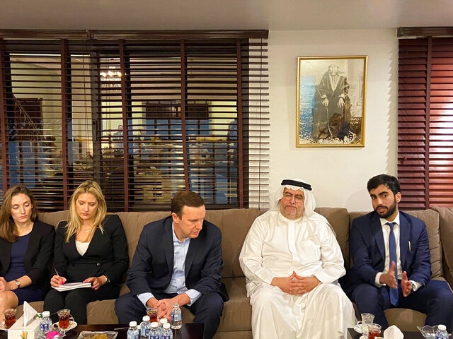 In this Saturday, Nov. 23, 2019 photo, provided by activists, U.S. Sen. Chris Murphy, D-Connecticut, center, listens to Adam Nabeel Rajab, right son of imprisoned Bahraini human rights activist Nabeel Rajab, at the family's home in Manama, Bahrain. Murphy had been in the kingdom for the annual Manama Dialogue security conference. (AP Photo)