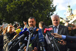 Italy's Interior Minister Matteo Salvini, left, and his German counterpart Horst Seehofer speak to media after a meeting in Innsbruck, Austria, on Wednesday, July 11, 2018. (AP Photo/Kerstin Joensson)