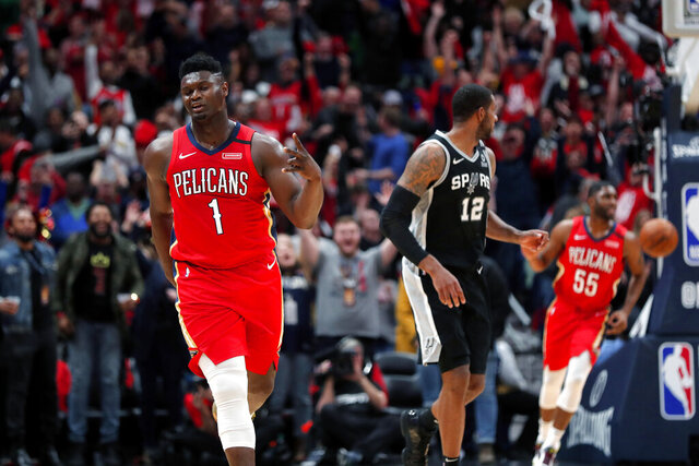 New Orleans Pelicans forward Zion Williamson (1) reacts after making a 3-point basket in the second half of an NBA basketball game against the San Antonio Spurs in New Orleans, Wednesday, Jan. 22, 2020. The Spurs won 121-117. (AP Photo/Gerald Herbert)