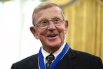 Former football coach Lou Holtz smiles after receiving the Presidential Medal of Freedom from President Donald Trump, in the Oval Office of the White House, Thursday, Dec. 3, 2020, in Washington. (AP Photo/Evan Vucci)
