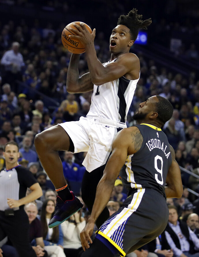 San Antonio Spurs' Lonnie Walker IV, left, shoots against Golden State Warriors' Andre Iguodala (9) during the first half of an NBA basketball game Wednesday, Feb. 6, 2019, in Oakland, Calif. (AP Photo/Ben Margot)