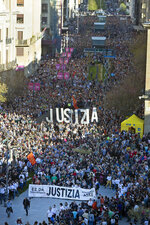 In this photo taken on Saturday April 14, 2018, tens of thousands of people march in Pamplona, the capital of the province where Alsasua is located, protesting the terrorism charges brought against eight defendants for a fight in a bar. A trial over the beating of two police officers and their girlfriends two years ago in a bar in the small town of Alsasua, northern Spain opened Monday April 16, 2018 surrounded by controversy because of the terrorism charges brought against the eight defendants. Banner reads ' Justice'. (AP Photo/Unai Beroiz)