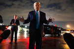 President Donald Trump talks with reporters at Andrews Air Force Base after attending a campaign rally in Latrobe, Pa., Thursday, Sept. 3, 2020, at Andrews Air Force Base, Md. (AP Photo/Evan Vucci)