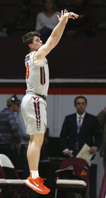 Hunter Cattoor (0) of Virginia Tech shoots a 3-point basket in the first half of an NCAA college basketball game in Blacksburg Va. Wednesday, Nov. 20 2019. (Matt Gentry/The Roanoke Times via AP)