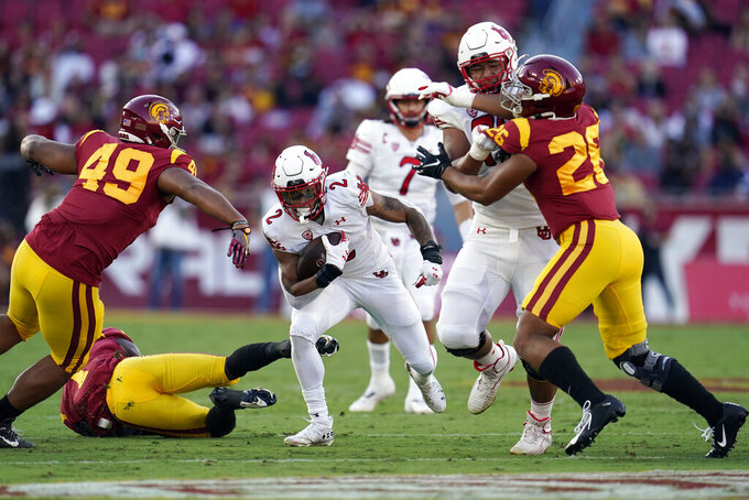 Utah running back Micah Bernard (2) carries during the first half of the team's NCAA college football game against Southern California on Saturday, Oct. 9, 2021, in Los Angeles. (AP Photo/Marcio Jose Sanchez)