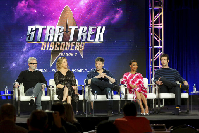 """FILE - In this Jan. 30, 2019 file photo, Alex Kurtzman, from left, Heather Kadin, Anson Mount, Sonequa Martin-Green and Ethan Peck participate in the """"Star Trek: Discovery"""" show panel during the CBS All Access presentation at the Television Critics Association Winter Press Tour at The Langham Huntington in Pasadena, Calif. Paramount+ debuts Thursday, March 4, 2021 as the latest — and last — streaming option from a major media company, this time from ViacomCBS.  The company hopes its smorgasbord of offerings — live sports and news, reboots of its properties like """"Frasier"""" and """"Rugrats,"""" original shows like """"Star Trek: Discovery"""" and the ViacomCBS library will entice viewers(Photo by Willy Sanjuan/Invision/AP, File)"""