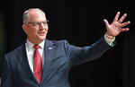 Gov. John Bel Edwards acknowledges his supporters as he comes out on stage for a debate with Eddie Rispone and Republican Rep. Ralph Abraham as they participate in the first televised gubernatorial debate Thursday Sept. 19, 2019, in Baton Rouge, La. (Bill Feig/The Advocate via AP, Pool)
