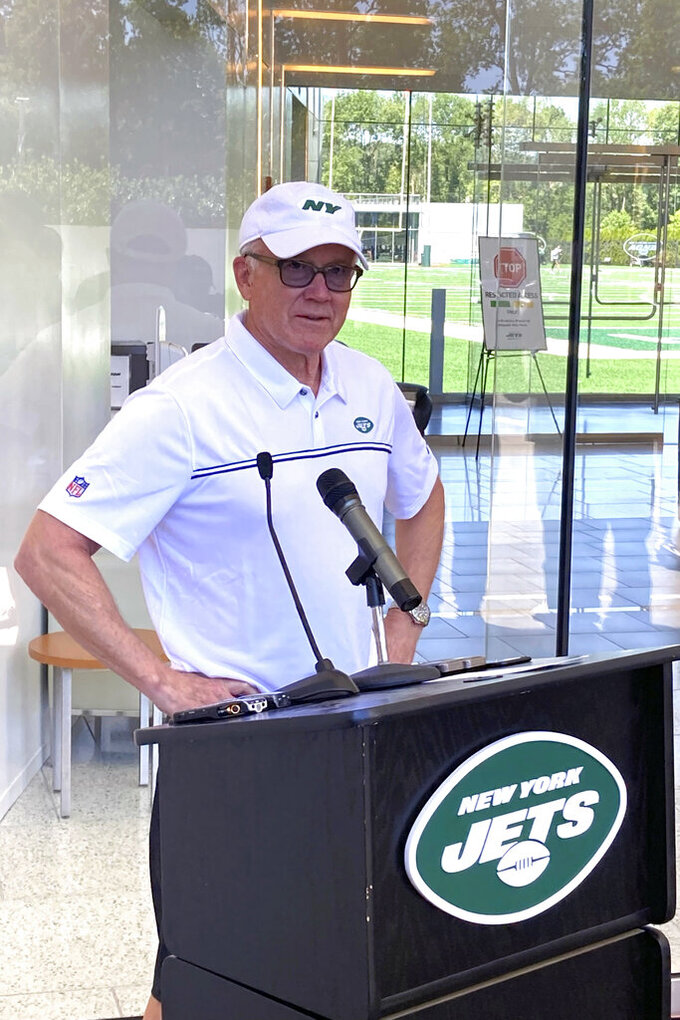 New York Jets owner and chairman Woody Johnson speaks to reporters at the team's NFL football facility in Florham Park, N.J, Wednesday, June 16, 2021. (AP Photo/Dennis Waszak Jr.)