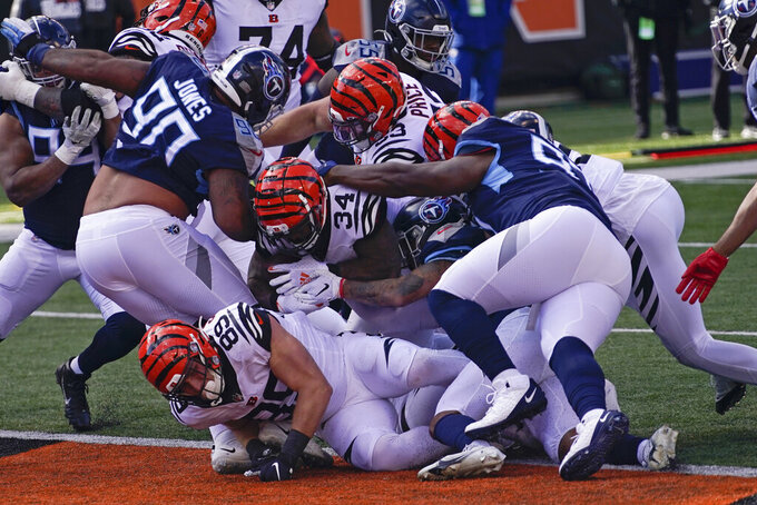 Cincinnati Bengals' Samaje Perine (34) runs in for a touchdown during the first half of an NFL football game against the Tennessee Titans, Sunday, Nov. 1, 2020, in Cincinnati. (AP Photo/Bryan Woolston)