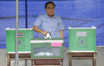 In this Sunday, Aug. 7, 2016, photo, Thai Prime Minister Prayuth Chan-ocha pauses as he casts his vote in a referendum on a new constitution at a polling station in Bangkok, Thailand. Prayuth became prime minister in a very Thai way: He led a military coup. Now after five years of running Thailand with absolute power, he's seeking to hold on to the top job through the ballot box. (AP Photo/Sakchai Lalit)