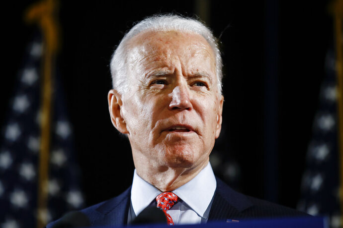 FILE - In this March 12, 2020, file photo, Democratic presidential candidate former Vice President Joe Biden speaks in Wilmington, Del. Biden expects to name a vice presidential vetting committee next week. That's according to three Democrats with knowledge of the situation who spoke to The Associated Press on condition of anonymity to discuss internal plans. (AP Photo/Matt Rourke)