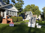 A political display is set up in the lawn of a home in Mason, Mich., seen Friday, Sept. 18, 2020.  Barb Byrum, the Democratic clerk of Ingham County, filed a complaint with police over the display, saying it could mislead people who aren't familiar with how mail-in voting works.  (Matthew Dae Smith/Lansing State Journal via AP)
