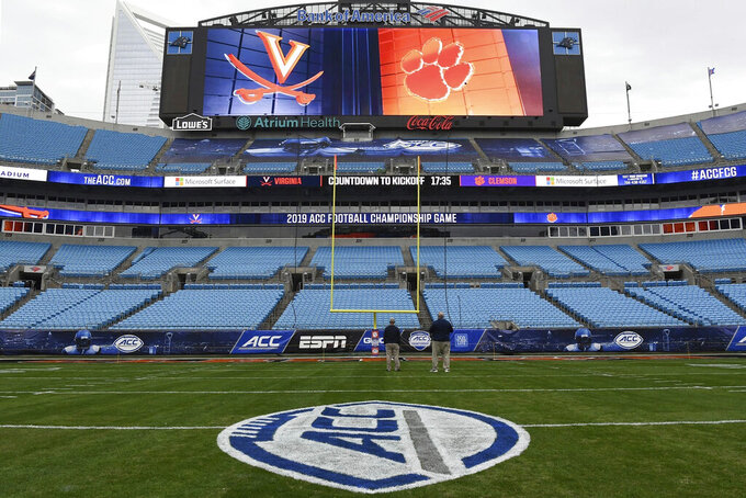 FILE - In this Dec. 6, 2019, file photo, the ACC Championship logo is displayed on the field before an NCAA college football game at Bank of America Stadium in Charlotte, N.C. The Atlantic Coast Conference announced an updated COVID-19 rescheduling policy on Thursday that means teams unable to play scheduled games because of pandemic-related protocols on its roster will be forced to forfeit. The policy will affect teams in football, field hockey, men's and women's soccer and volleyball. (Ken Ruinard/The Independent-Mail via AP, File)