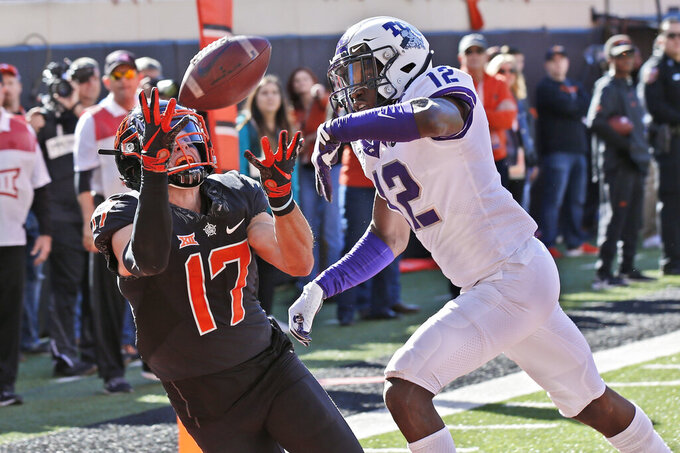 Oklahoma State wide receiver Dillon Stoner (17) catches a pass for a touchdown in front of TCU cornerback Jeff Gladney (12) in the first half of an NCAA college football game in Stillwater, Okla., Saturday, Nov. 2, 2019. (AP Photo/Sue Ogrocki)