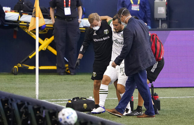 Portland Timbers midfielder Sebastian Blanco is helped off the pitch with an injury during the first half of an MLS soccer match against the Seattle Sounders, Sunday, Sept. 6, 2020, in Seattle. Blanco did not return to play. (AP Photo/Ted S. Warren)