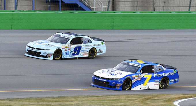 Justin Allgaier (7) battles Noah Gragson (9) for position during the NASCAR Xfinity Series auto race at Kentucky Speedway in Sparta, Ky., Friday, July 12, 2019. (AP Photo/Timothy D. Easley)