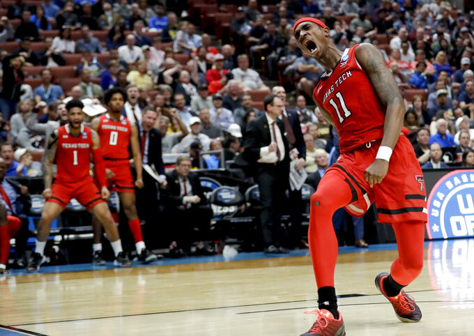 Texas Tech forward Tariq Owens celebrates after scoring against Michigan during the second half an NCAA men's college basketball tournament West Region semifinal Thursday, March 28, 2019, in Anaheim, Calif. (AP Photo/Marcio Jose Sanchez)