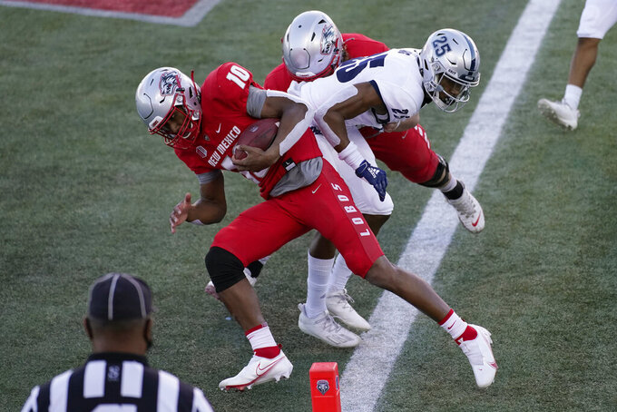 New Mexico quarterback Trae Hall (10) runs into the end zone for a touchdown against Nevada during the first half of an NCAA college football game Saturday, Nov. 14, 2020, in Las Vegas. (AP Photo/John Locher)