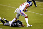 New York Giants' Golden Tate, right, breaks free of Philadelphia Eagles' Cre'Von LeBlanc to score a touchdown during the first half of an NFL football game, Thursday, Oct. 22, 2020, in Philadelphia. (AP Photo/Derik Hamilton)