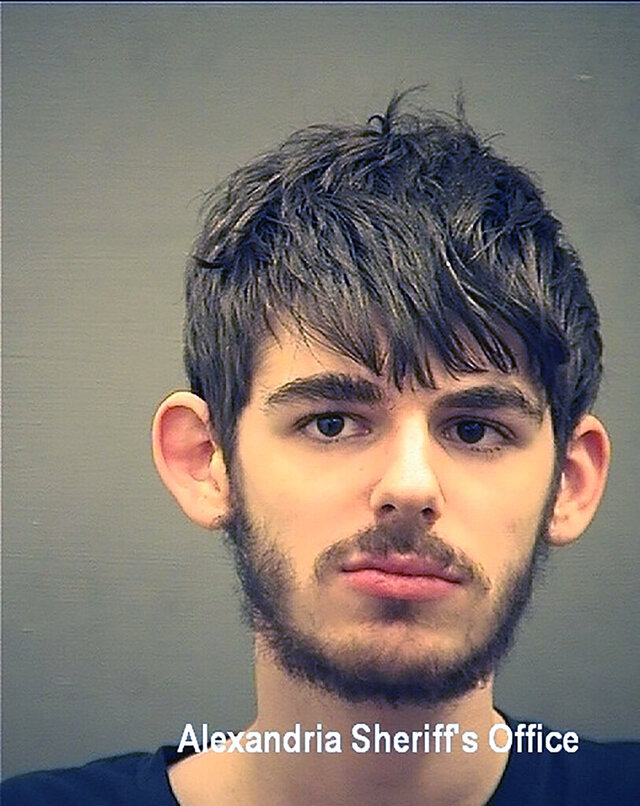 This photo provided by the Alexandria Sheriff's Office, in Virginia, shows John William Kirby Kelley. Kelley, a former Old Dominion University student who targeted his school with a fake bomb threat so he could skip class, has pleaded guilty to a swatting conspiracy that ended up encompassing a neo-Nazi leader and others who targeted a Black church, a news outlet and a Cabinet secretary. (Alexandria Sheriff's Office via AP)